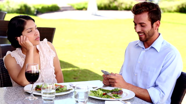 bored woman being ignored by her date - shrugging stock videos and b-roll footage