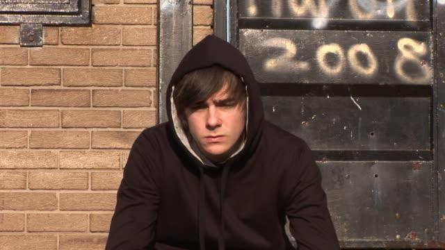 Bored Youth / Hoody Staring at camera with Graffiti