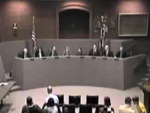 a boring city council meeting turns hilarious when one of the members lets go a loud fart that is picked up by the microphones they try but cannot go... - ausrutscher stock-videos und b-roll-filmmaterial