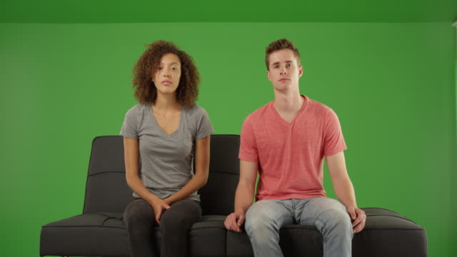 boring couple staring at the camera on a futon couch on green screen - psychiatrist's couch stock videos and b-roll footage