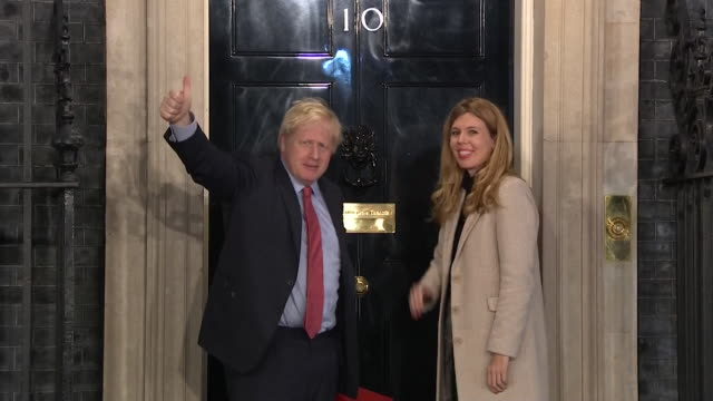 boris johnson and carrie symonds arrive at 10 downing street after the conservative party's majority election victory - winning stock videos & royalty-free footage