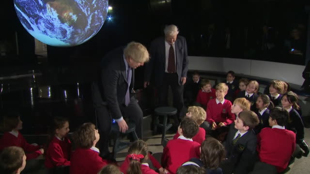 boris johnson and david attenborough hosting an audience with children at the science museum - planet space stock videos & royalty-free footage