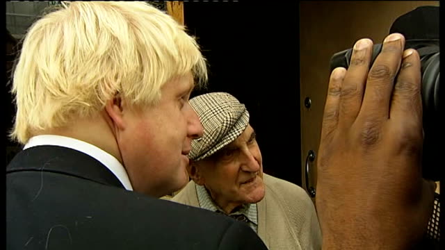 boris johnson and eric pickles on tour of tottenham; boris meeting owner of barber shop damaged by riots , barber touching boris johnson's hair and... - damaged stock videos & royalty-free footage