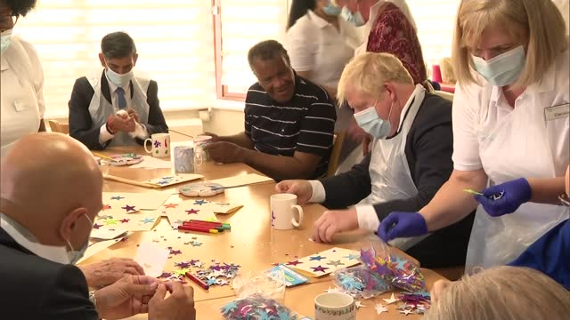 boris johnson announces national insurance tax rise; england: east london: int various of residents, nurses, sajid javid mp , boris johnson mp and... - craft stock videos & royalty-free footage