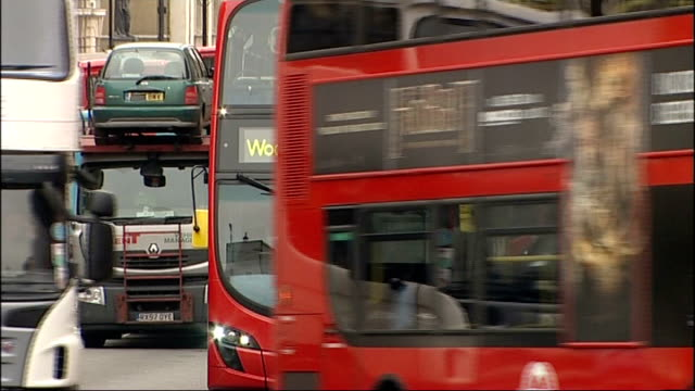 boris johnson announces price freeze in real terms on transport fares london ext london red buses along road boris johnson and assistant on bikes... - charing cross stock videos and b-roll footage
