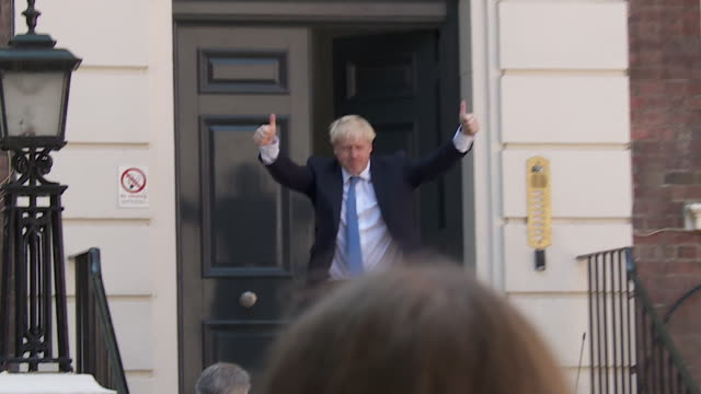 boris johnson arriving at conservative campaign hq with party leader brandon lewis after becoming the new conservative party leader gives thumbs up - boris johnson stock videos & royalty-free footage