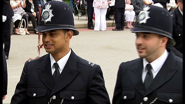 boris johnson at metropolitan police 'passing out' parade england london hendon police college ext police officer posing for photographs / police... - passing out parade stock videos & royalty-free footage