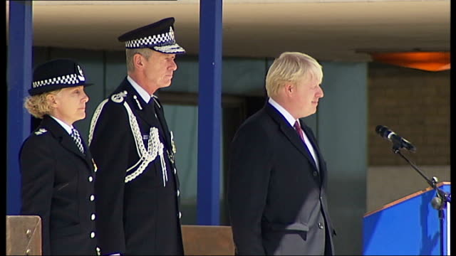boris johnson at metropolitan police 'passing out' parade johnson and hoganhowe with unidentified woman on stage / police officers lined up - passing out parade stock videos & royalty-free footage