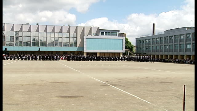 boris johnson at metropolitan police 'passing out' parade **music heard sot** new police officers along into parade ground for passing out ceremony /... - passing out parade stock videos & royalty-free footage