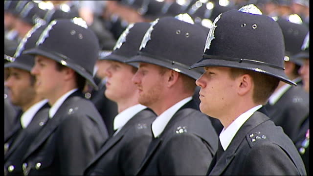 boris johnson at metropolitan police 'passing out' parade **music heard sot** police officers standing to attention and saluting - passing out parade stock videos & royalty-free footage