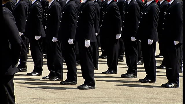 boris johnson at metropolitan police 'passing out' parade police officers standing in line / senior police officer calling orders - passing out parade stock videos & royalty-free footage