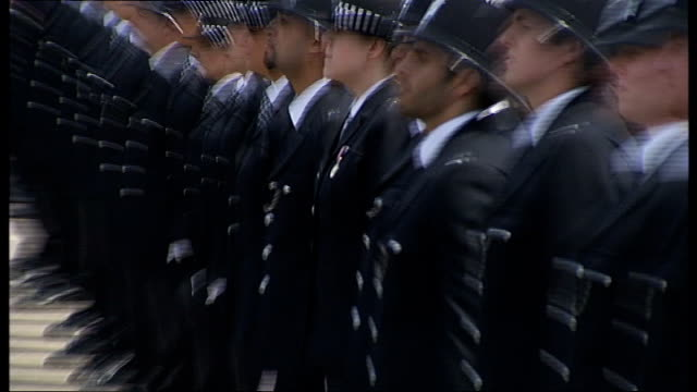 boris johnson at metropolitan police 'passing out' parade police officers lined up in parade ground / police officers standing to attention - passing out parade stock videos & royalty-free footage