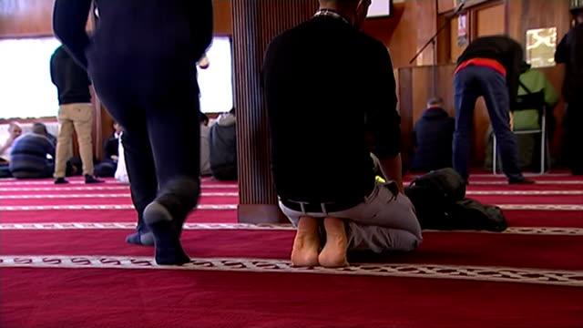 boris johnson attacks 'loser' jihadists t09011517 int anonymous shots of muslim men praying in mosque - jihad stock videos & royalty-free footage