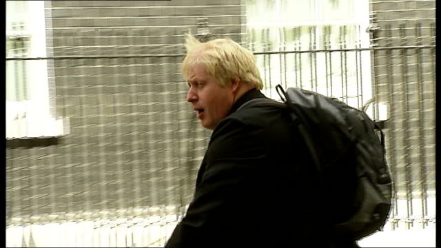 boris johnson attends meeting at number 10 with david cameron england london downing street ext boris johnson arriving on bicycle at number 10 - 10 downing street stock videos and b-roll footage