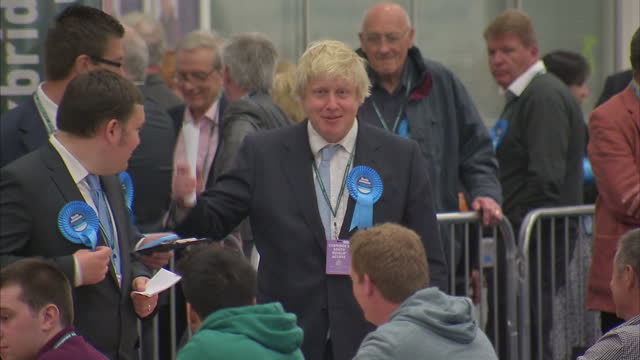 boris johnson attends vote counting in his constituency of uxbridge shows interior shots boris johnson in the counting hall shaking hands with vote... - british liberal democratic party stock videos and b-roll footage