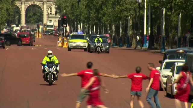 boris johnson becomes new prime minister and appoints new cabinet ministers england london the mall ext police motorbikes along the mall and... - people in a line stock videos & royalty-free footage