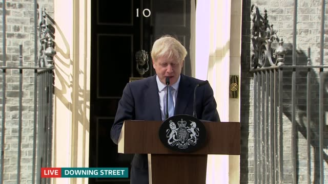 itv news special 1500 1600 england london downing street various of boris johnson motorcade along through gates boris johnson mp up to podium boris... - itv news at one stock videos & royalty-free footage