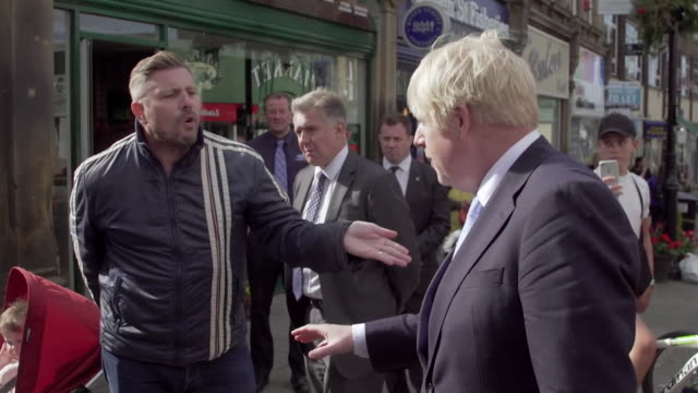 boris johnson being berated by a member of public and speaking to crowds in morley - politician stock videos & royalty-free footage