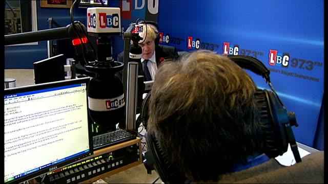 vídeos de stock, filmes e b-roll de boris johnson comments on tpims on lbc radio england london lbc radio int boris johnson in radio studio with nick ferrari answering caller's question... - vestimenta religiosa