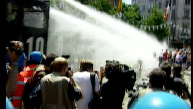 boris johnson criticised after water cannon denied licence by home office; lib - 17.6.2000 belgium: charleroi: gv english fans sprayed with water... - water cannon stock videos & royalty-free footage