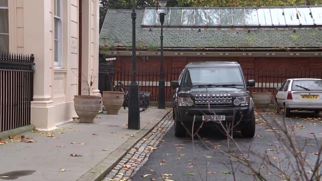 London Carlton Gardens EXT Boris Johnson MP along to car ignoring reporters