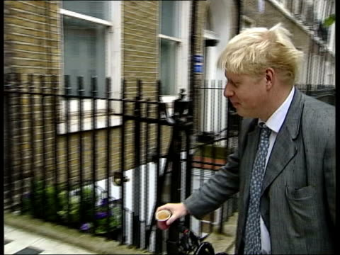 stockvideo's en b-roll-footage met boris johnson fired from conservative party front bench boris johnson mp pushing bicycle along to door pan - mp