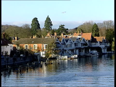 boris johnson fired from conservative party front bench england henleyonthames houses at riverside tlms people strolling along riverbank swan on... - oxfordshire stock videos and b-roll footage