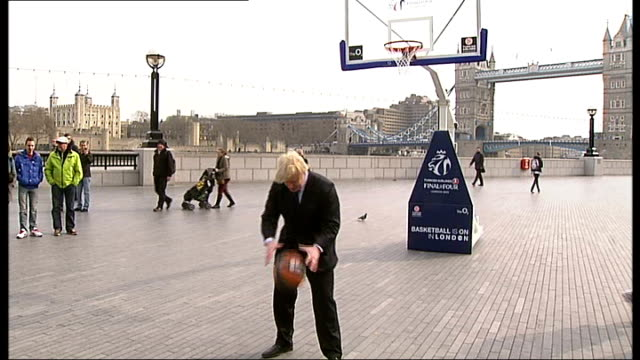 boris johnson helps to promote finals of euroleague basketball tournament; england: london: ext boris johnson performs trick basketball shot,... - stunt stock videos & royalty-free footage