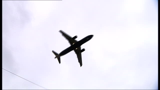 Boris Johnson hires Olympic architect to develop plans for new London hub airport LIB AIR shot of plane flying low over houses Thames Estuary EXT...