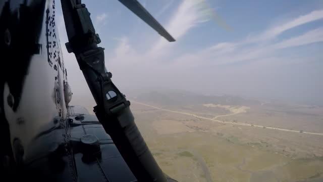 Boris Johnson in a plane flying over burned down Rohingya villages in Rakhine State Burma