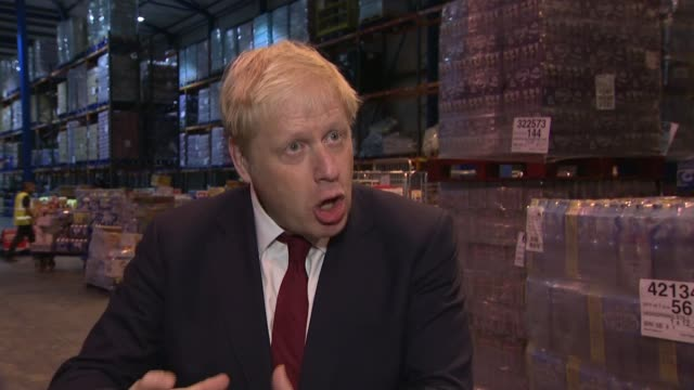 boris johnson interview / boris johnson and sajid javid visit wholesaler warehouse; england: manchester: newton heath: bestway wholesale: int boris... - built structure stock videos & royalty-free footage