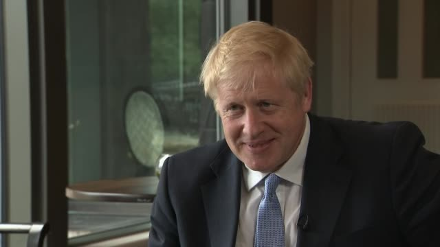 boris johnson interview on irish backstop and hong kong protests; northern ireland: belfast: int boris johnson mp interview sot. - alternative to the... - out of context stock videos & royalty-free footage