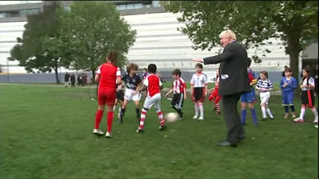 boris johnson knocks over 10yearold boy during rugby game r15101415 / city hall johnson tripping boy up while playing football johnson at world... - boris johnson stock videos & royalty-free footage