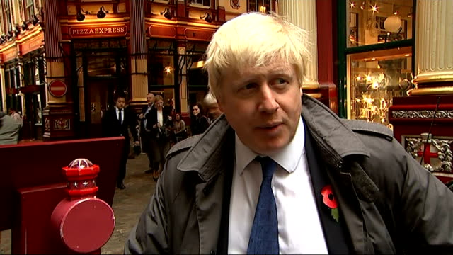 Boris Johnson launches new book 'The Churchill Factor' ENGLAND London EXT Woman holding copy of book 'The Churchill Factor' / people outside...