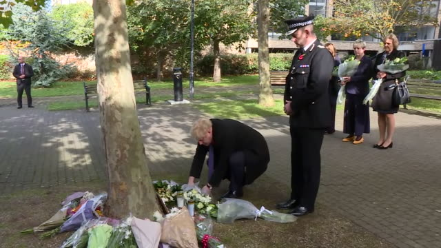 boris johnson laying flowers for the 39 migrants found dead on the back of a refrigerated lorry in grays essex - grey stock videos & royalty-free footage