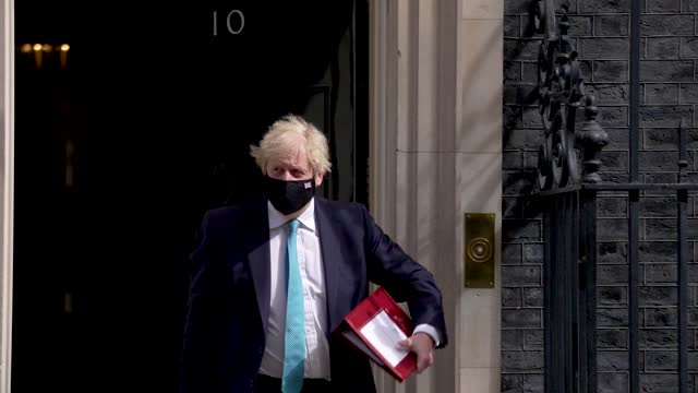 boris johnson leaves downing street ahead of the the state opening of parliament at downing street on may 11, 2021 in london, england. - politics and government stock videos & royalty-free footage