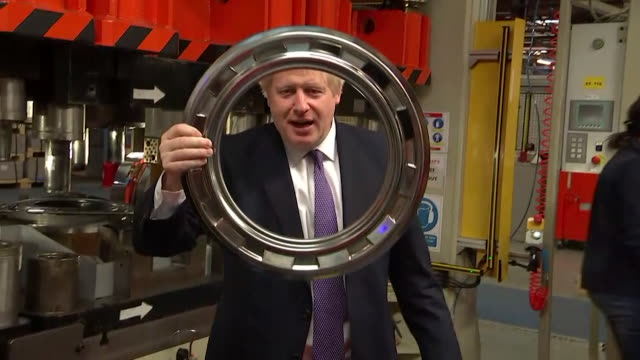 boris johnson looks through metal ring at washing machine factory during general election campaign trail in country durham - looking stock videos & royalty-free footage
