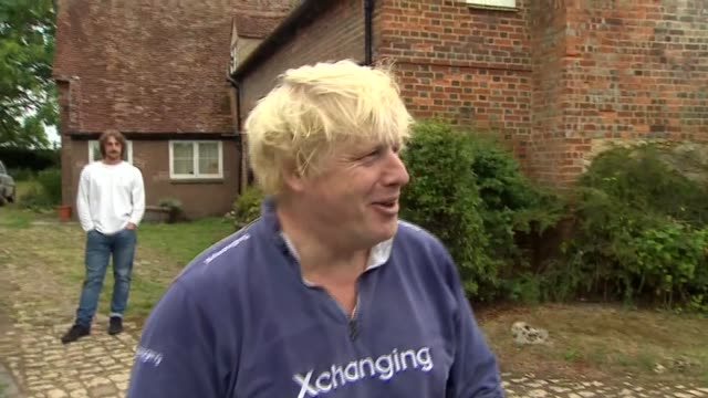 boris johnson offers tea to reporters as avoiding questions on burqa comments england oxfordshire thame ext boris johnson mp along from house... - oxfordshire video stock e b–roll