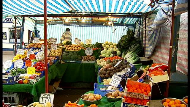 boris johnson opens dlr station at woolwich fruit and vegetables displayed on greengrocer's market stall market stalls next to station entrance peter... - lebensmittelhändler stock-videos und b-roll-filmmaterial