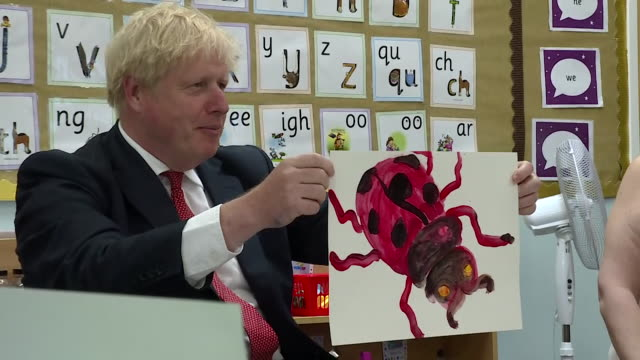 boris johnson paints a picture of a ladybird during visit to primary school in kent - insect stock videos & royalty-free footage
