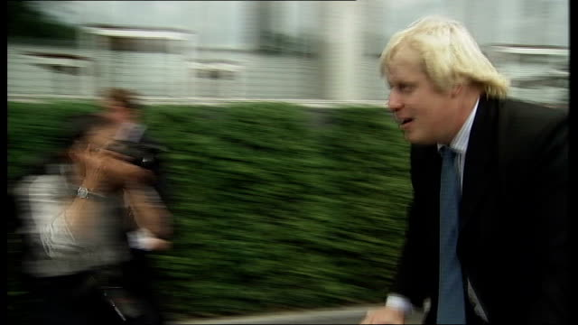 boris johnson photocall on bicycle 2004 johnson wearing running shorts, fleece and skull and crossbones hat jogging towards - running shorts stock videos & royalty-free footage