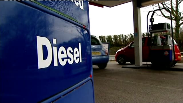 boris johnson plans to penalise diesel drivers to cut air pollution t22021336 / tx cardiff diesel sign at petrol station motorist filling car with... - unleaded stock videos and b-roll footage