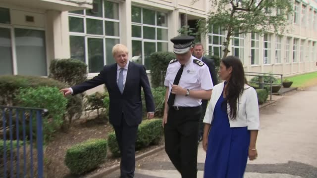 boris johnson pledges 20000 new police officers boris johnson and priti patel in birmingham england west midlands birmingham ext motorcade arriving... - priti patel stock-videos und b-roll-filmmaterial