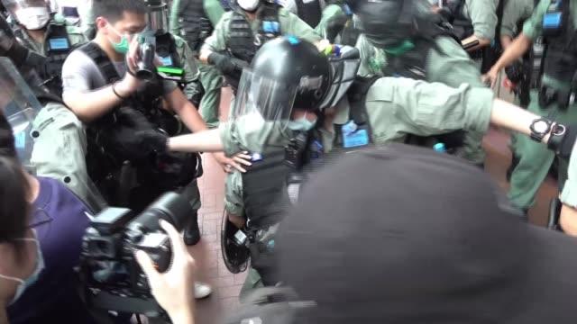 boris johnson pledges to give hong kong citizens uk rights after china breaches handover treaty; hong kong: ext various shots of protesters wearing... - hong kong stock videos & royalty-free footage