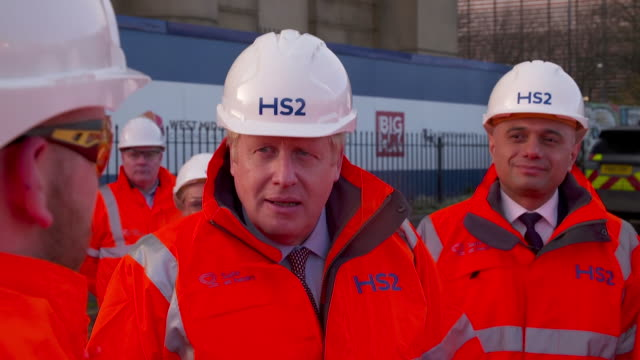 boris johnson pm and chancellor sajid javid visit hs2 construction site in birmingham - 内閣改造点の映像素材/bロール