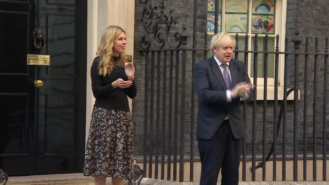 boris johnson pm and fiancee carrie symonds, clape for carers during the coronavirus pandemic, outside 10 downing street - city of westminster london stock videos & royalty-free footage