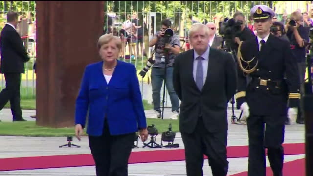 boris johnson pm and german chancellor angela merkel walking together at official arrival at german chancellery berlin before press conference - angela merkel stock videos & royalty-free footage