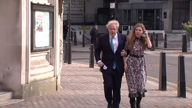 boris johnson pm and partner carrie symonds, arrival and departure from polling station as they vote in local elections - conservative party uk stock videos & royalty-free footage