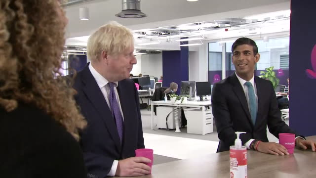 boris johnson pm and rishi sunak, chancellor of the exchequer, visit octopus energy, boris gives elbow bumps as a greeting - b roll stock videos & royalty-free footage