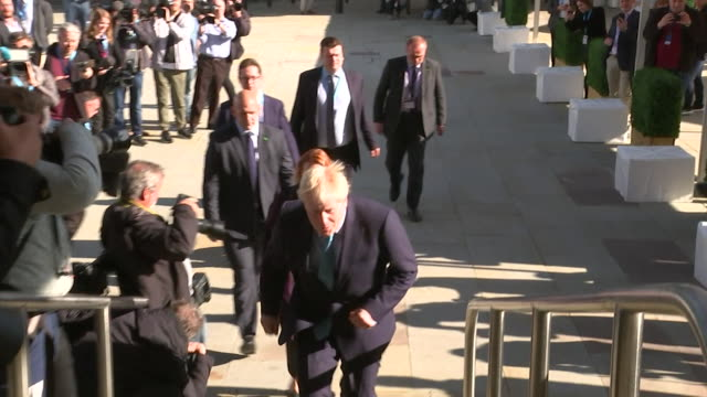 boris johnson pm arrives at the conservative party conference in manchester for the day he gives his leaders speech - boris johnson stock videos & royalty-free footage